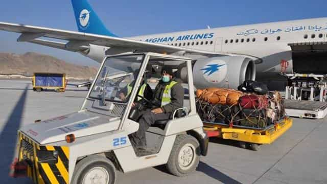 Goods being loaded on to the first flight from Kabul airport under the new Afghanistan-India air car