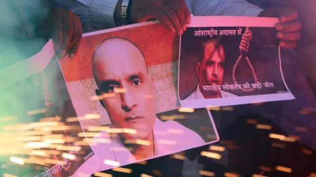 People with posters of Kulbhushan Jadhav celebrate the International Court of Justice's stay on his