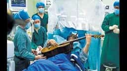 playing guitar while brain surgery
