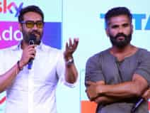 Suniel Shetty and Ajay Devgn at event