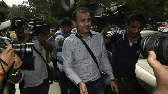 Virender Sehwag leaves the Cricket Centre after his interview. Get highlights of the Indian cricket