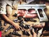 12 pistols seize by police in illegal arms factory